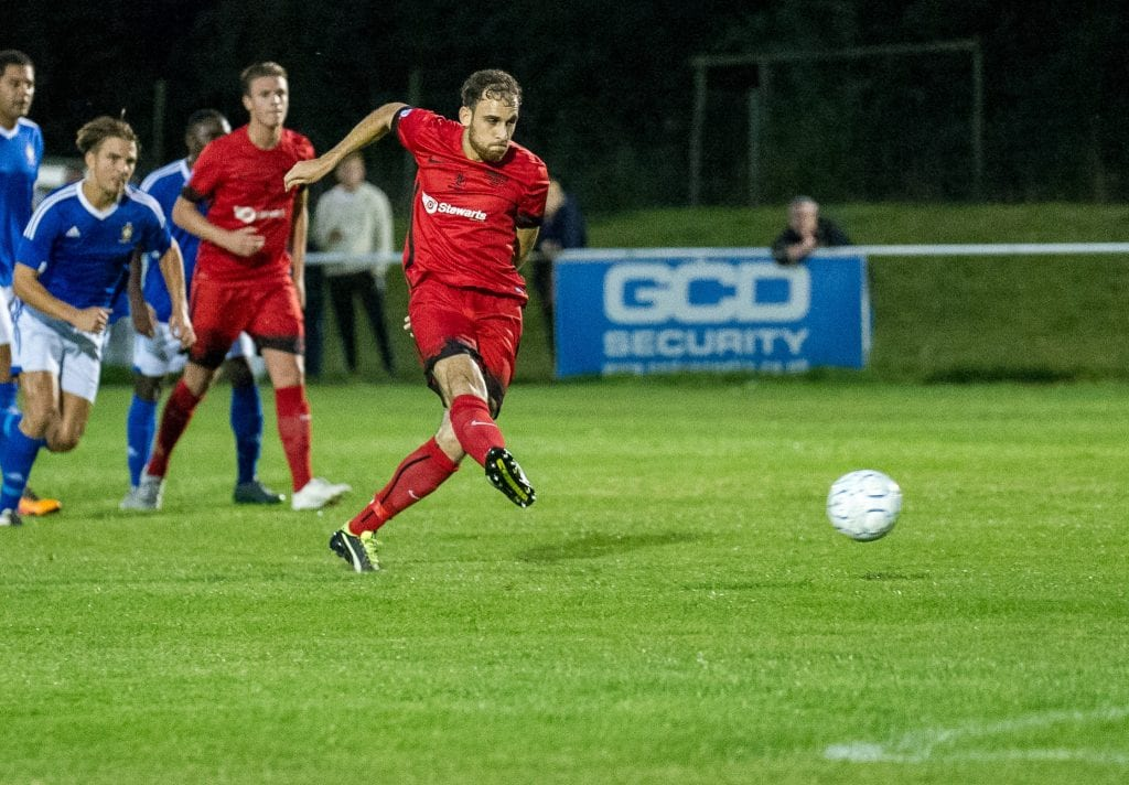 Liam Ferdinand scores a penalty for Binfield FC. Photo: Colin Byers.