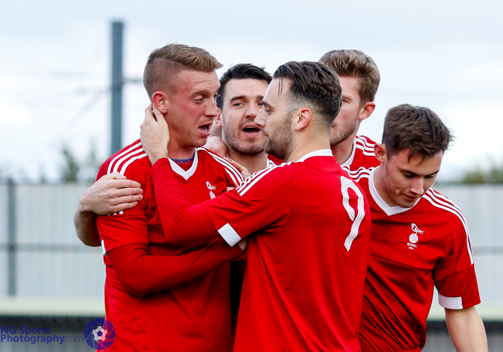 TJ Bohane is congratuled by Bracknell Town FC team mates. Photo: Neil Graham.