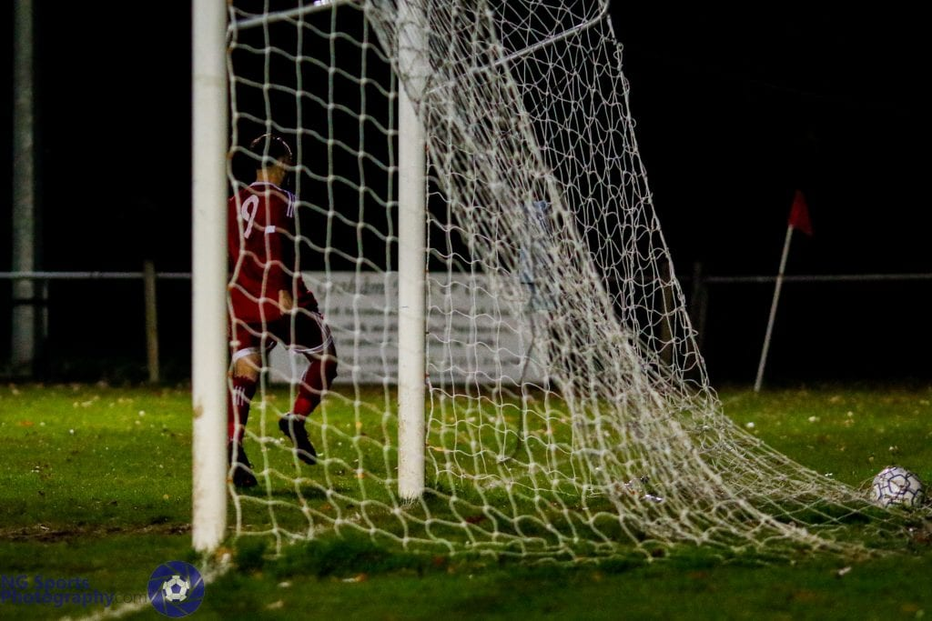 Adam Cornell wheels away after scoring Bracknell Town's fifth goal. Photo: Neil Graham.