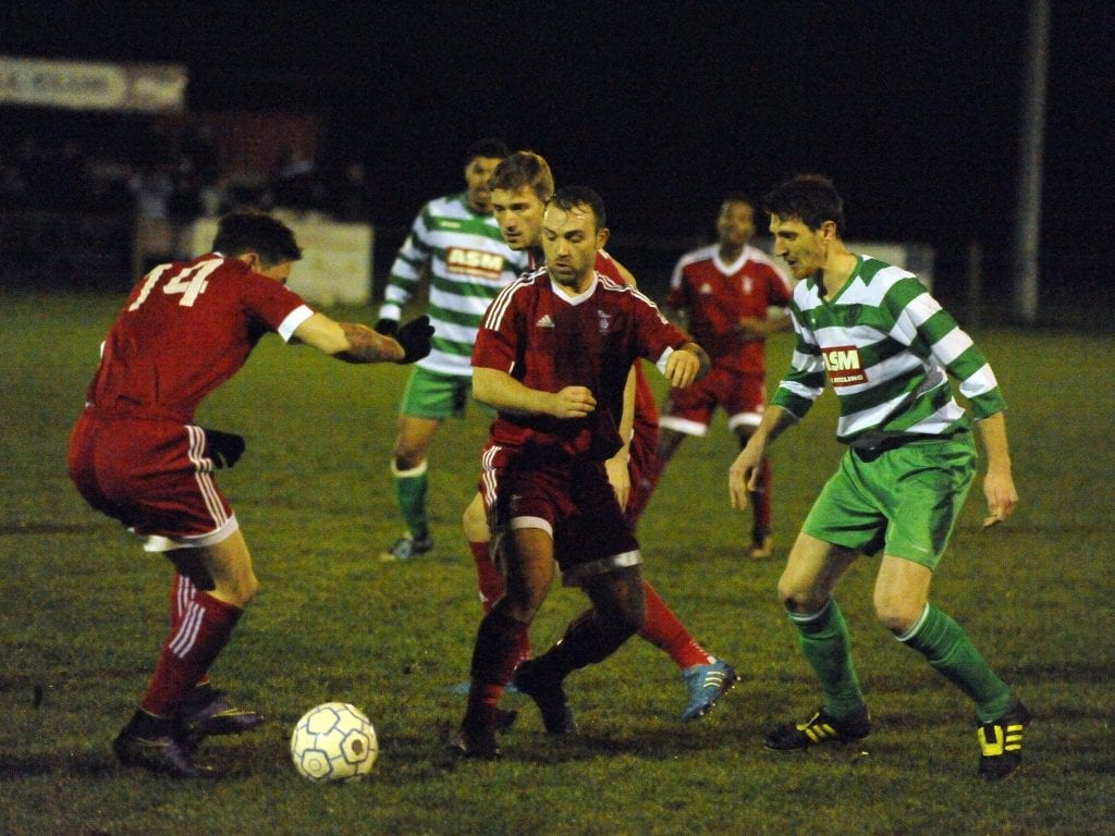 Jamie McClurg in action against Thame United. Photo: Mark Pugh.