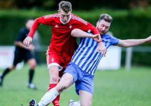 TJ Bohane takes on Thatcham Town for Bracknell Town. Photo: Neil Graham,