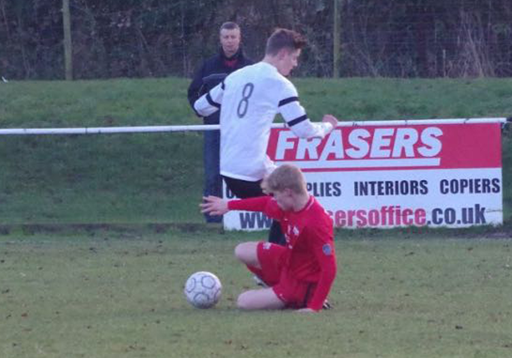George Armstrong makes a challenge for Binfield FC. Photo: James Green.