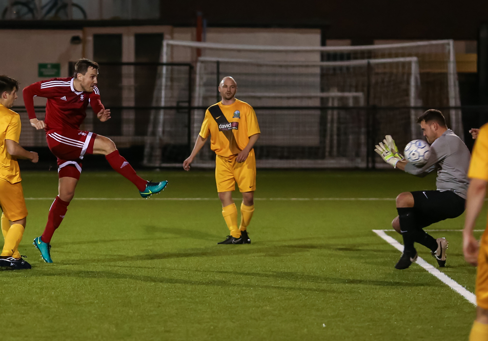 Bracknell Town FC midfielder Carl Withers fires at goal. Photo: Neil Graham.