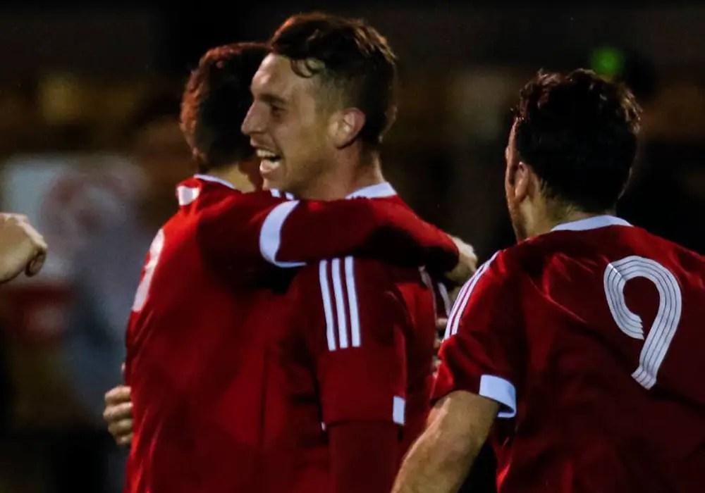 TJ Bohane celebrates a goal for Bracknell Town. Photo: Neil Graham.
