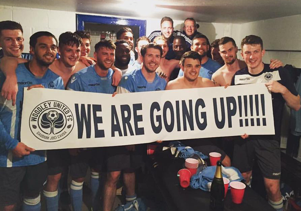 Woodley United celebrate promotion in the dressing room. Photo: @woodleyunitedfc