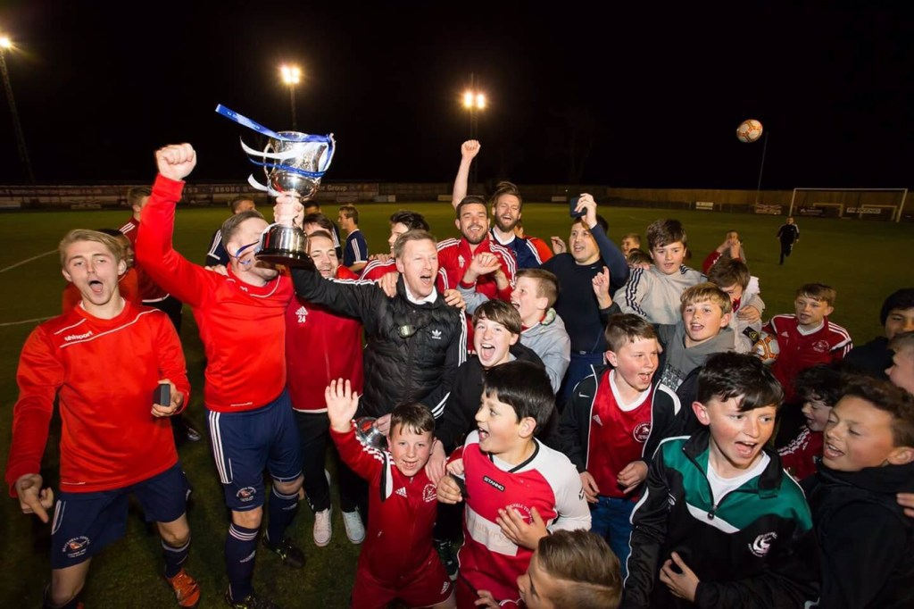 Bracknell Town FC celebrate with the County Cup. Photo: Richard Claypole.