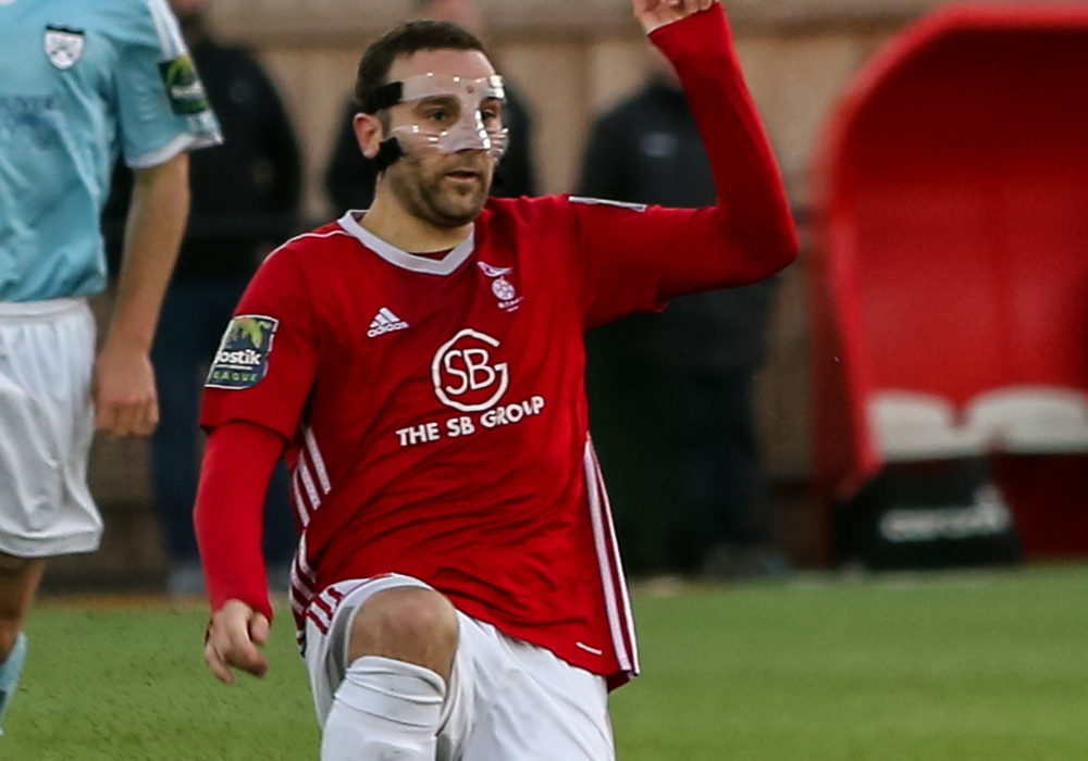 Adam Cornell wore a face mask against Hanwell Town. Photo: Neil Graham.