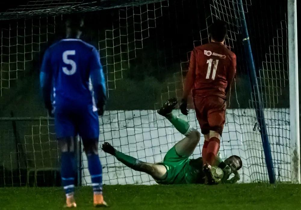 Matt Carr makes a Reading City penalty save. Photo: Neil Graham.
