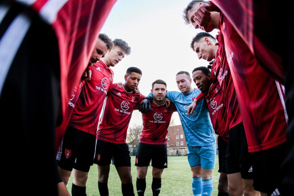 Bracknell Town huddle before Hanwell Town game. Photo: Neil Graham / ngsportsphotography.com