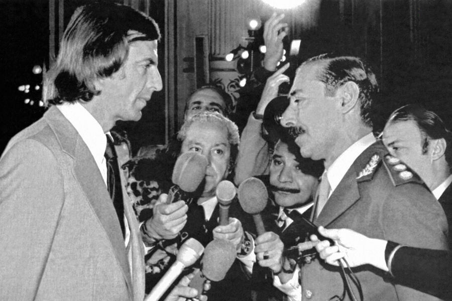 Menotti staring down dictator, General Videla.