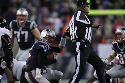 Umpire Chad Brown tries (unsuccessfully) to get out of the way of Patriots quarterback Tom Brady. (David Silverman/New England Patriots)