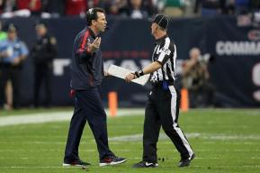 Texans coach Gary Kubiak discusses a call with side judge Jimmy DeBell. (Houston Texans photo)