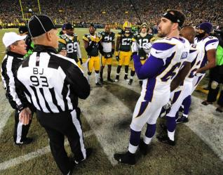 Referee Scott Green and back judge Scott Helverson preside over the coin toss. (Jim Biever/Green Bay Packers)