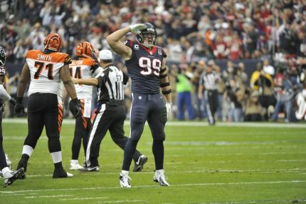 Referee Alberto Riveron makes sure that all parties return to a neutral corner after a sack by Texans defensive end J.J. Watt. (Houston Texans photo)