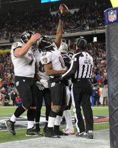 Back judge Perry Paganelli nudging the players to return to the sideline, as Ravens receiver Anquan Boldin celebrates a touchdown. (Baltimore Ravens photo)