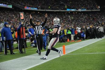 Head linesman Tony Veteri signals a touchdown by Patriots receiver Wes Welker. (Keith Nordstrom/New England Patriots)