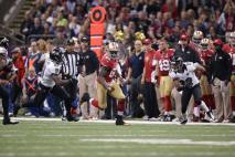 Line judge Byron Boston follows 49ers tight end Vernon Davis (San Francisco 49ers photo)