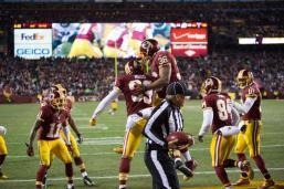 Side judge Laird Hayes dodges the celebration (Washington Redskins photo)