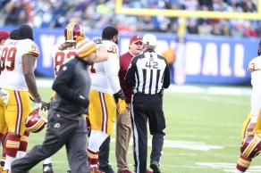 Jay Gruden argues with referee Jeff Triplette (Washington Redskins photo)