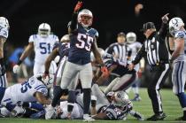 Keith Ferguson signals Patriots ball (New England Patriots photo)