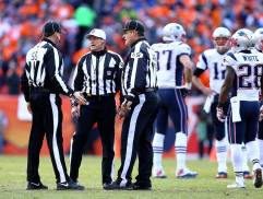 Hochuli confers with Baynes and Hall