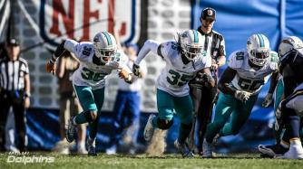 Jonah Monroe starting his timer and watching the line rush on a field goal attempt (Miami Dolphins)