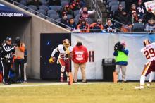 Tom Hill tosses his bean bag to mark change of possession (Washington Redskins)