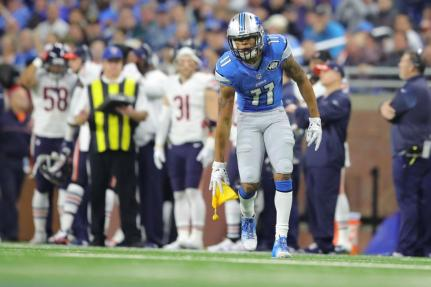 Marvin Jones Jr., places a penalty flag on the ground after catching it (Detroit Lions)