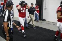 Julian Mapp escorts the Falcons onto the field (Atlanta Falcons)