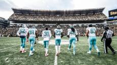 Greg Wilson leads the Dolphins to the coin toss (Miami Dolphins)