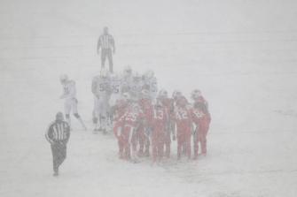 Brad Allen's crew works in the snow (Buffalo Bills)