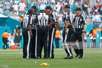 MIAMI GARDENS, FL - SEPTEMBER 9: Game officials sort out penalties after the Miami Dolphins and the Tennessee Titans came onto the field after a play during an NFL game on September 9, 2018 at Hard Rock Stadium in Miami Gardens, Florida. The Dolphins defeated the Titans 27-20. (Photo by Joel Auerbach/Getty Images)