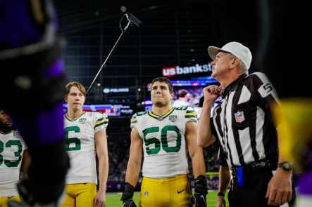 Bill Vinovich conducts the Packers-Vikings coin toss (Green Bay Packers)