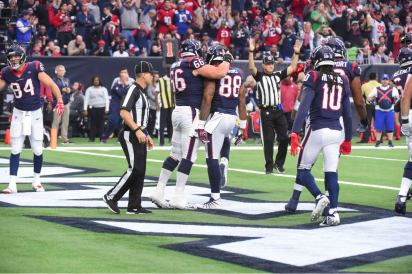 Back judge Steve Patrick. Mark Perlman is signalling the touchdown. (Houston Texans)