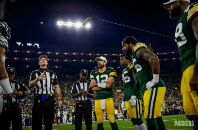 Clay Martin tosses the coin (Green Bay Packers)