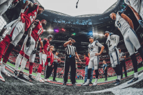 Ron Torbert tosses the coin (Los Angeles Rams).