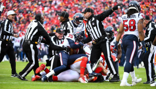 The Hochuli crew gets to the bottom of a fumble scrum (Tennessee Titans).