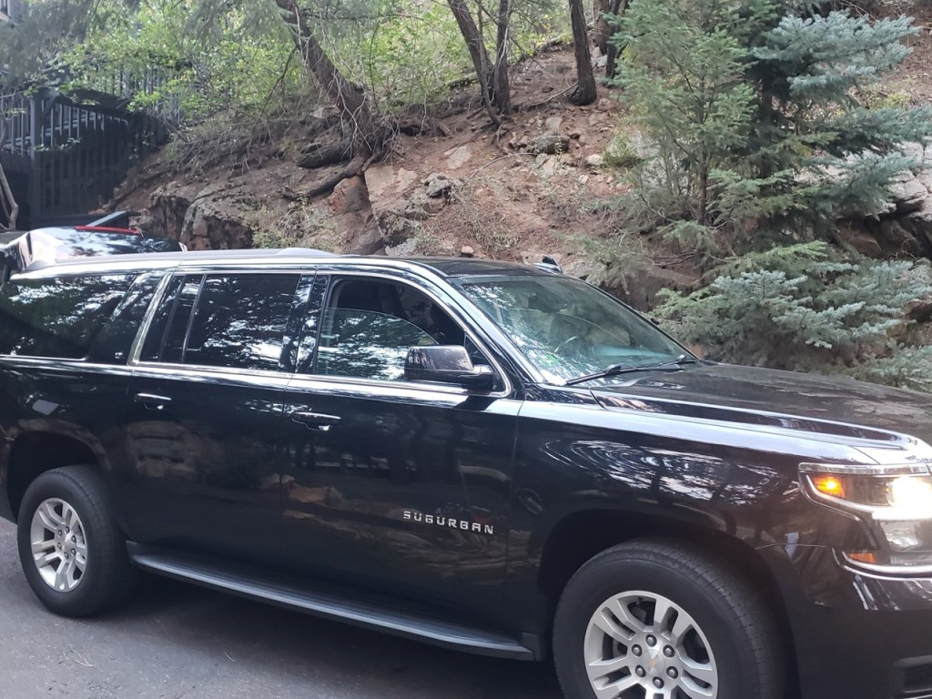 black SUV waiting for a ride at Evergreen Colorado