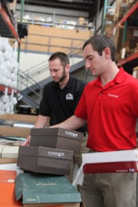 Chris and Josh work together to pack up the shoe donation Foot Levelers headquarters Roanoke VA