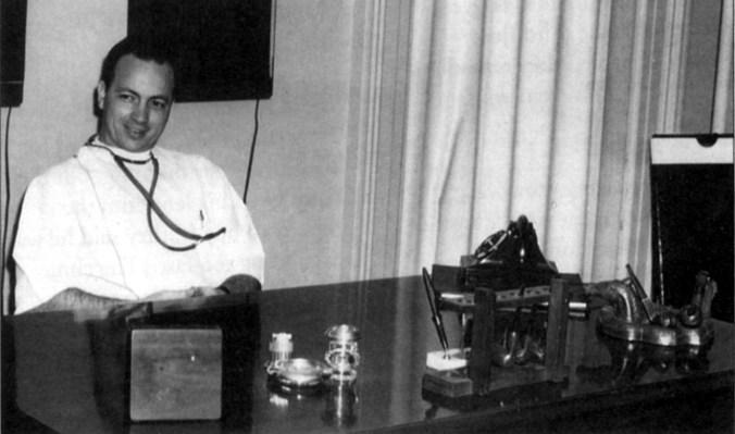 Dr. Monte Greenawalt at desk