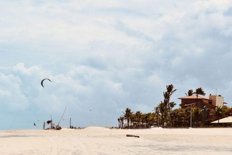 Cumbuco beach with kitesurfer and palm trees