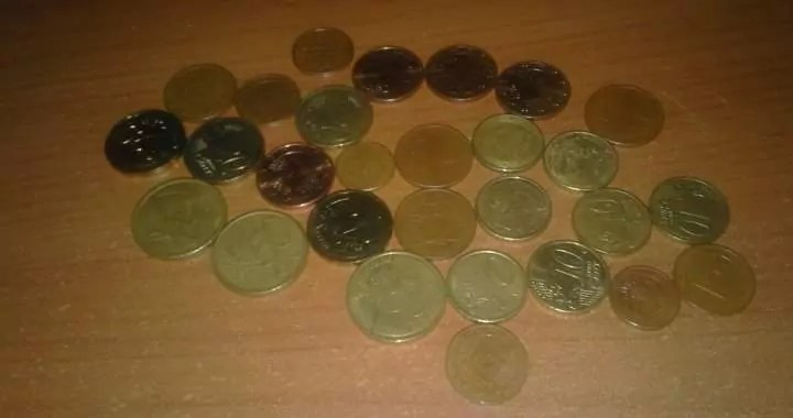 a few spare euro coins laying on a table small change representing the minimum wage.