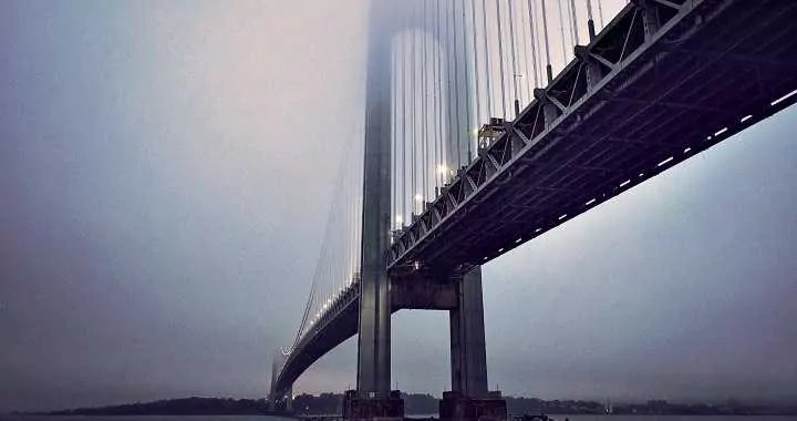 The Verrazano–Narrows Bridge physically connecting to an urbanised bay are over the sea.