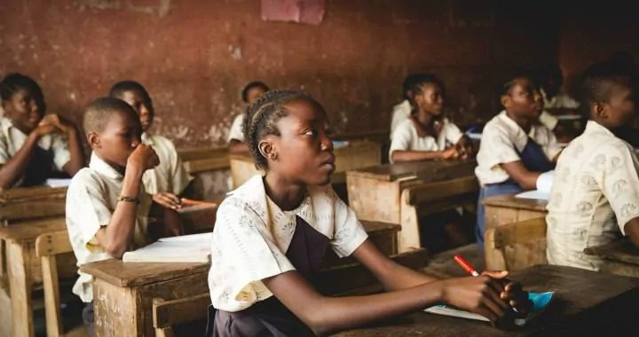 a classroom of African children studying and getting an education in Lagos Nigeria