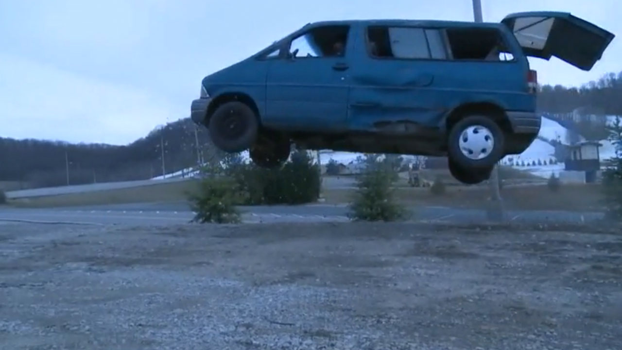 Hump Day Jump Ford Aerostar Van Jumps Over Two Cars