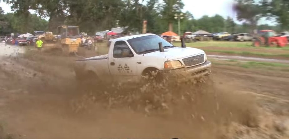 White Ford F-150 Mud Racer Side