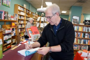 Dan signs an advance copy of The Gods of Second Chances at Broadway Books.