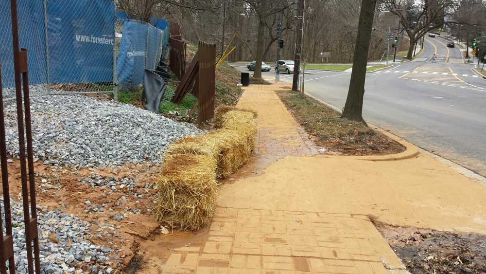 Orange clay covers the sidewalk on Tilden by the Embassy of Morocco's construction site.