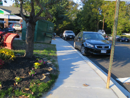 The new sidewalk, looking north on 36th Street from Fessenden.