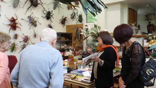 Joan Danziger, second from the right, explains some of her work to guests.